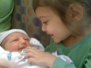 Addyson holding baby Owen